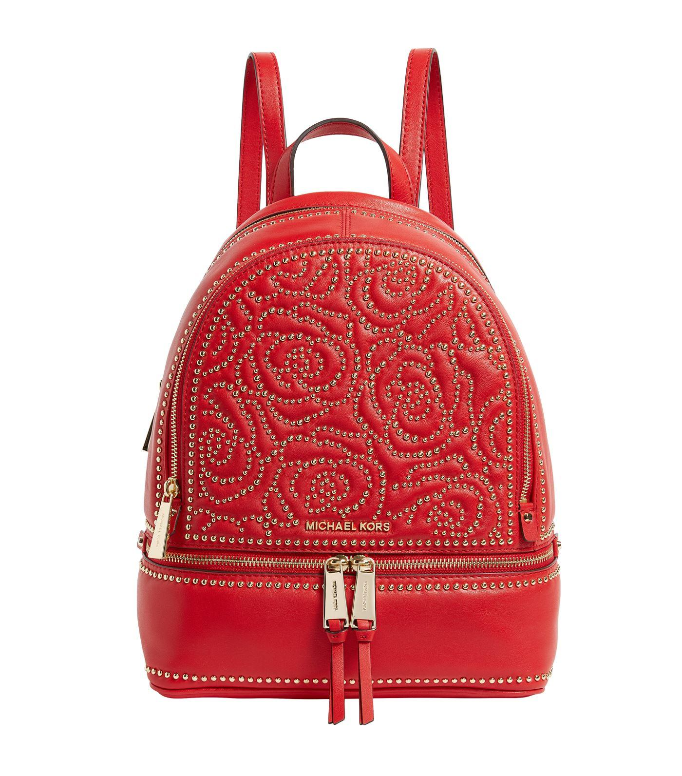 8a4117f9a65 Lyst - MICHAEL Michael Kors Medium Studded Rhea Backpack in Red