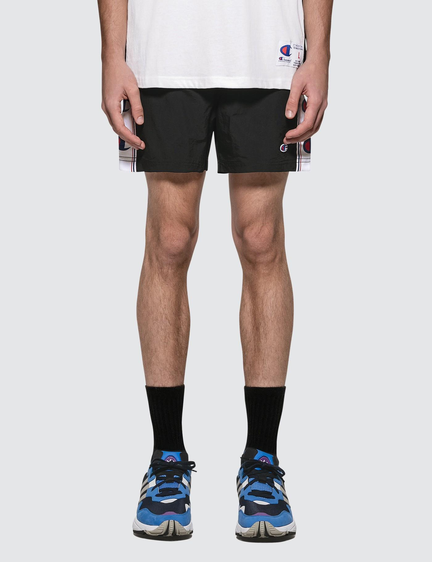 333fb9c3 Champion - Black Side Logo Beach Shorts for Men - Lyst. View fullscreen