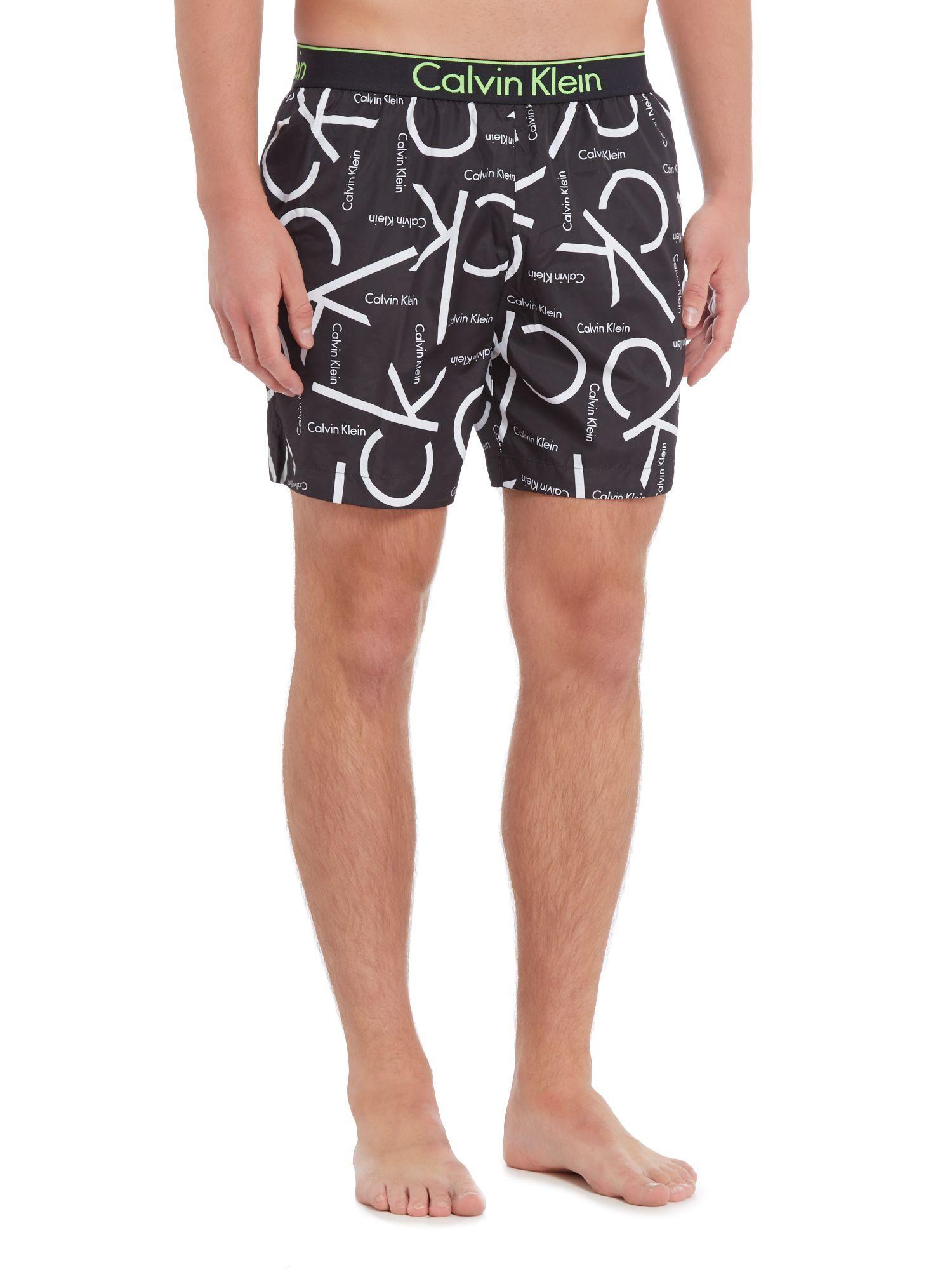 lyst calvin klein ck print swim shorts in black for men. Black Bedroom Furniture Sets. Home Design Ideas
