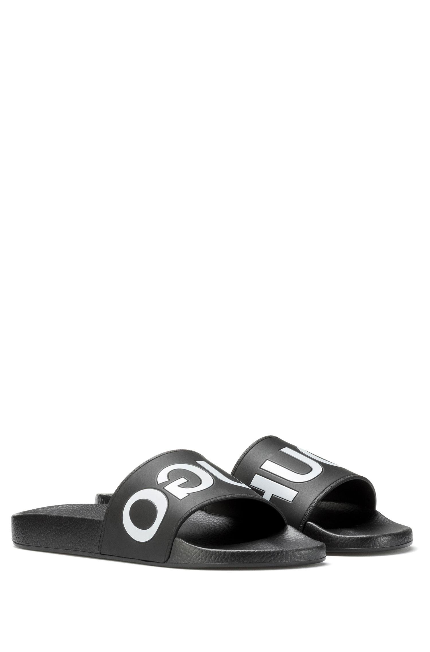 900f7cd6b8a2 HUGO - Black Reverse-logo Pool Sliders for Men - Lyst. View fullscreen