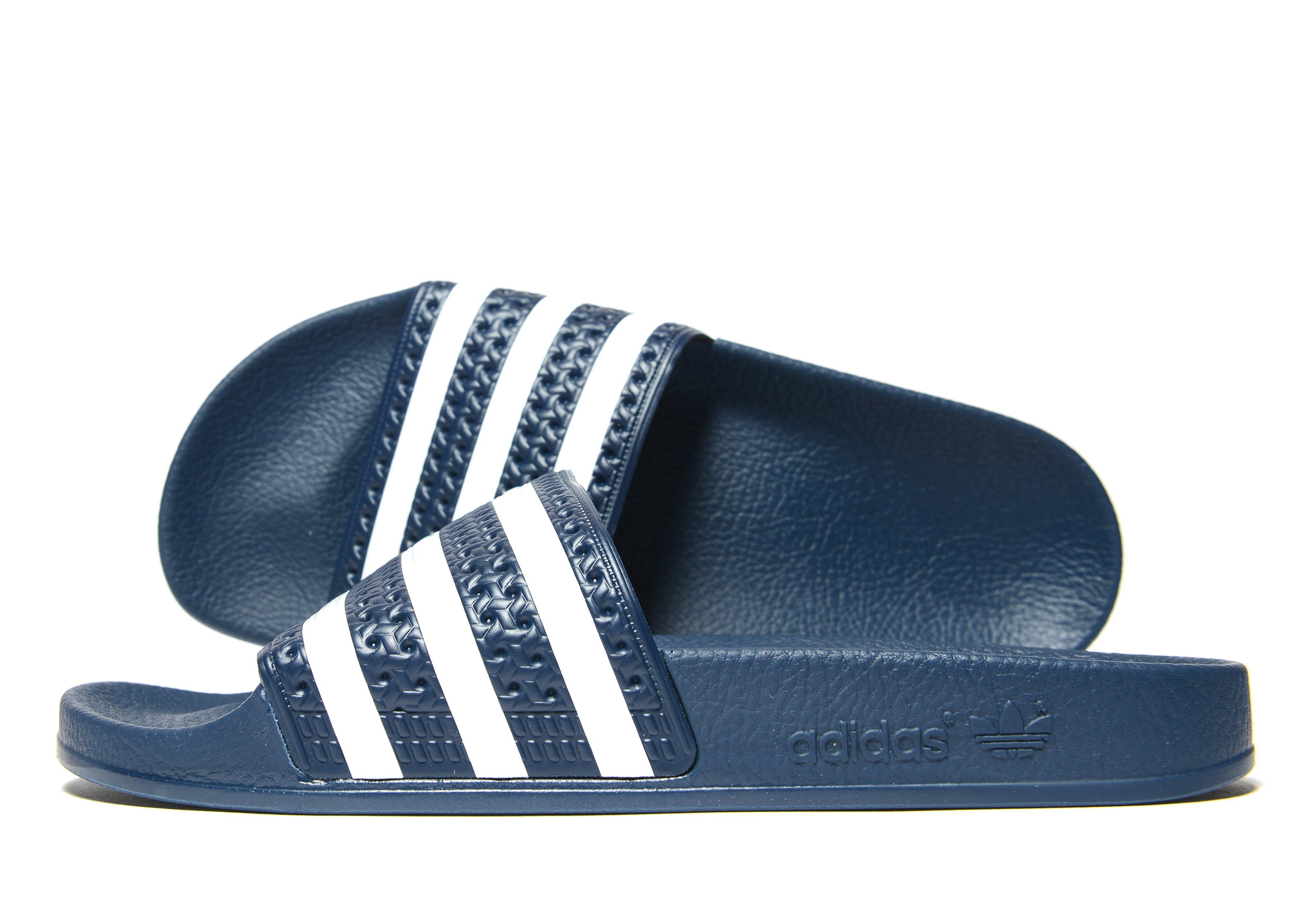 5975af94ca1bd1 Adidas Originals - Blue Adilette Slides - Lyst. View fullscreen