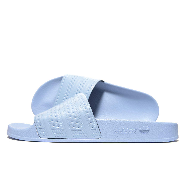 new styles 6b22f c3532 adidas Originals. Men s Blue Adilette Slides