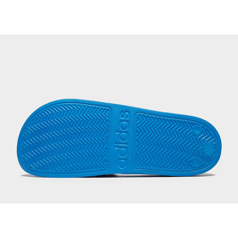 674424b0c6fe13 Adidas Originals - Blue Adilette Cloudfoam Slides for Men - Lyst. View  fullscreen