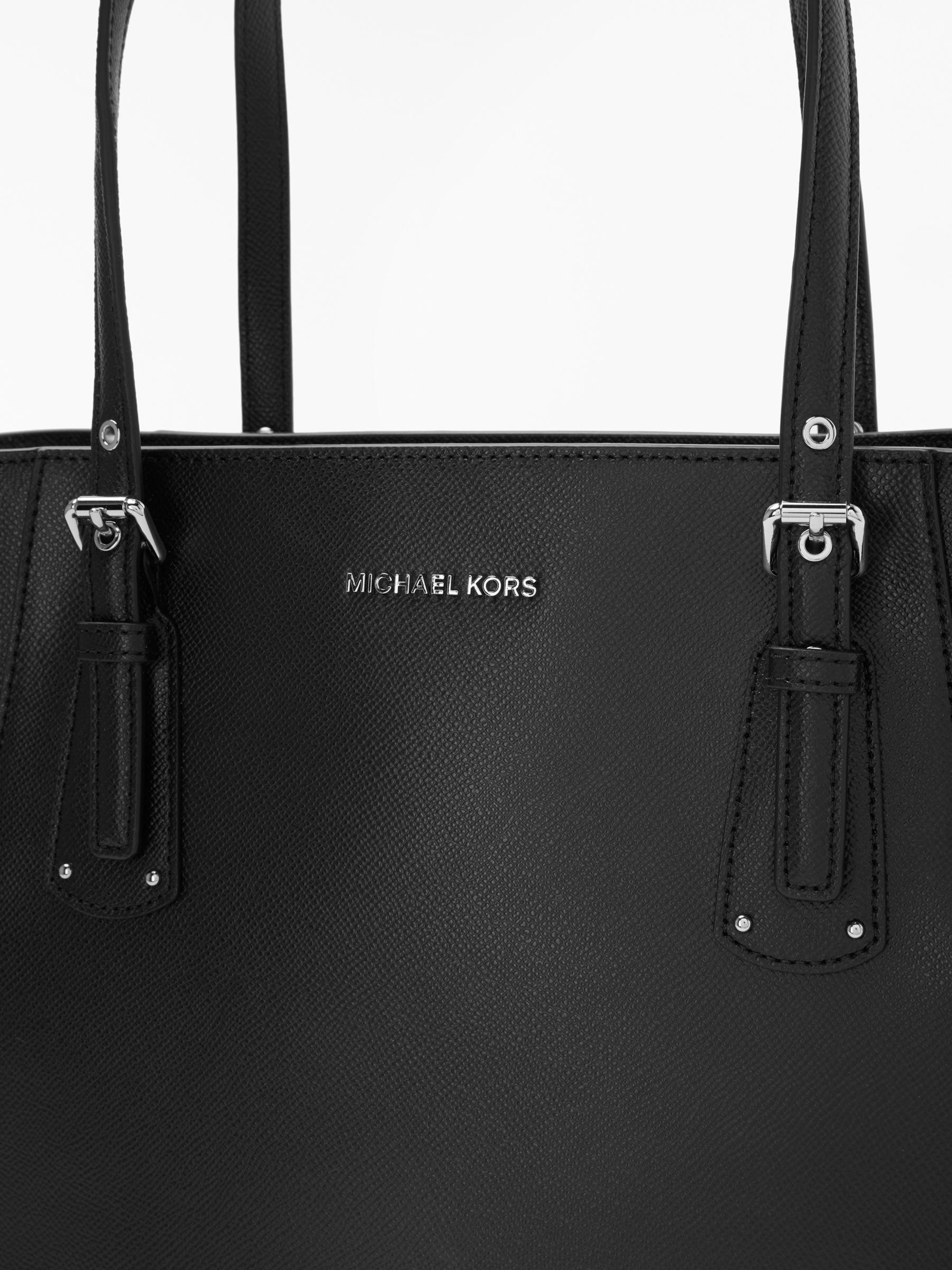 11717933e2fe Michael Kors - Black Michael Voyager East West Leather Tote Bag - Lyst.  View fullscreen