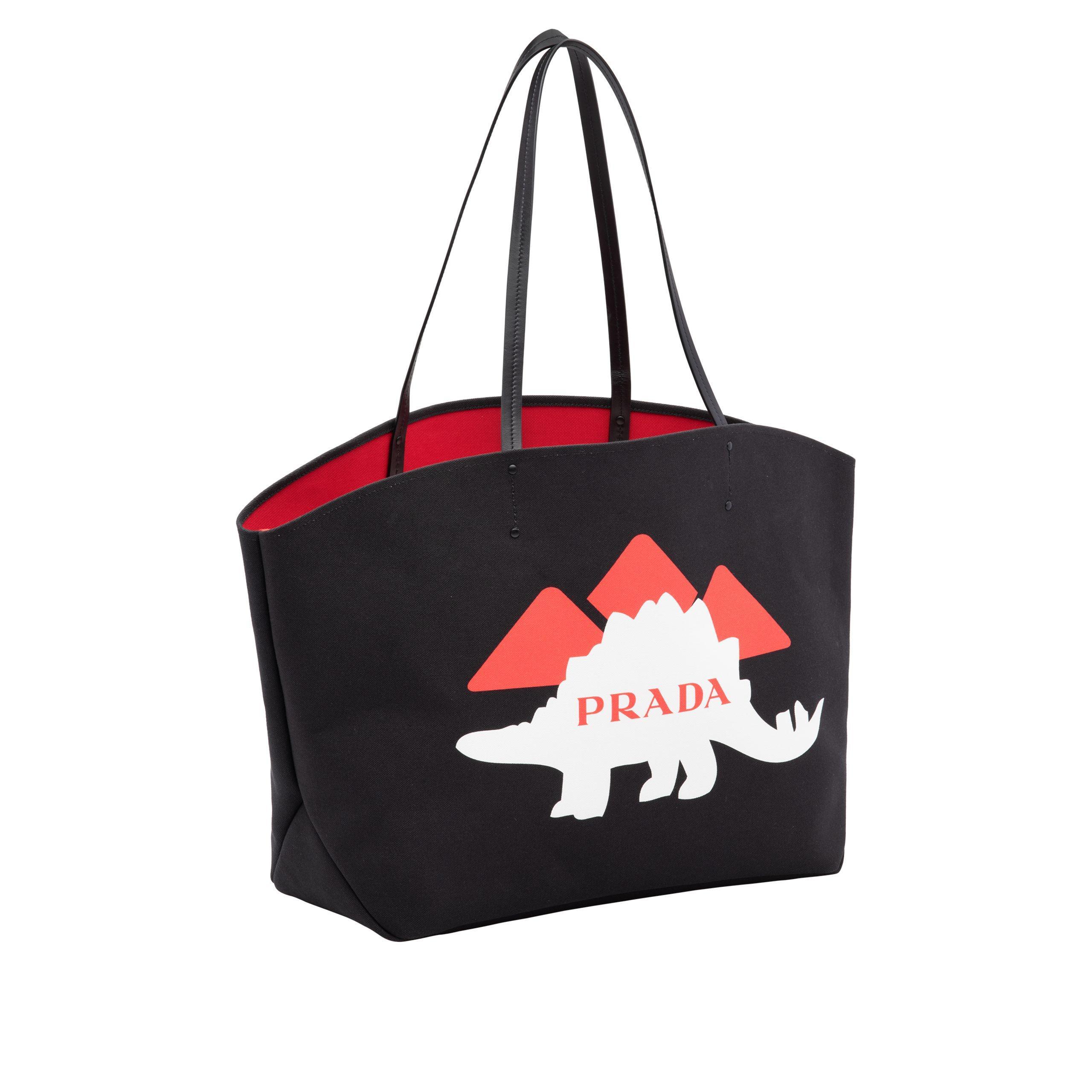 5a0fc4b3c1f7 Lyst - Prada Dinosaur Printed Canvas Black Tote Bag in Black