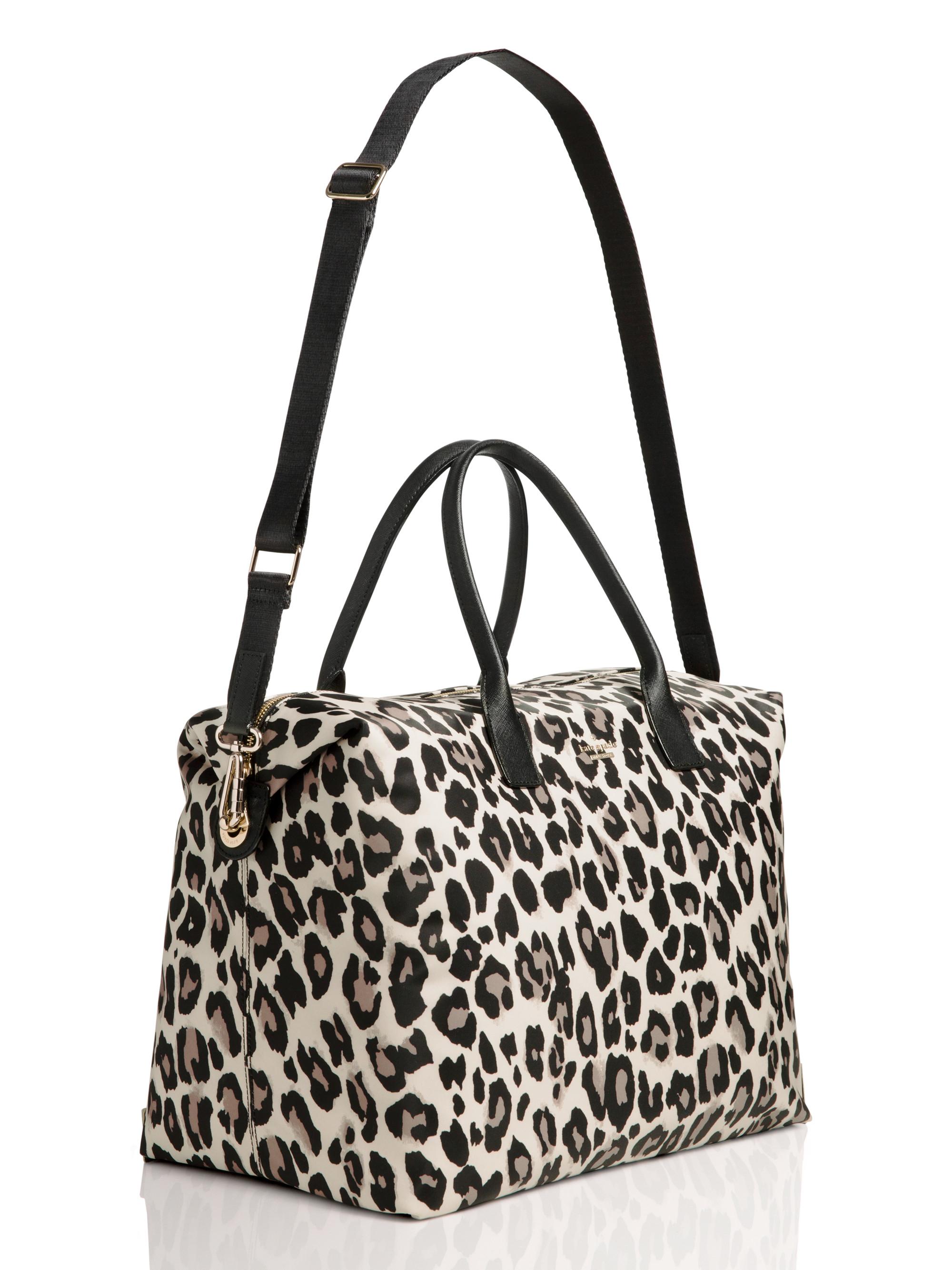 df1df4d99210 Lyst kate spade new york lyla leopard print weekender bag jpg 2000x2666  Purple leopard coach weekender