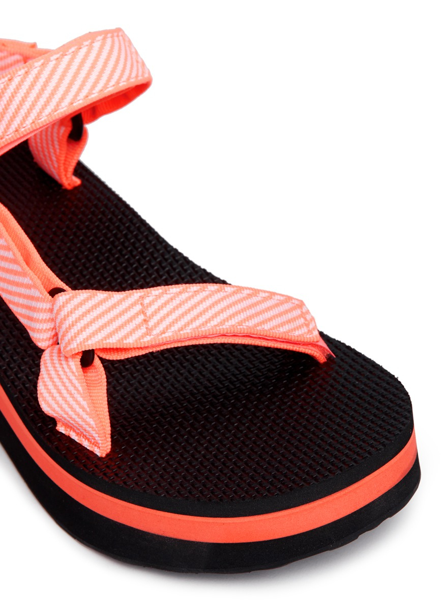 fd12577aaa4bfb Lyst - Teva  flatform Universal  Candy Stripe Print Sandals in Orange