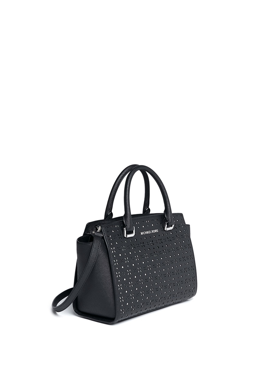 c23c4e4bac20 Lyst - Michael Kors  selma  Medium Perforated Leather Satchel in Black