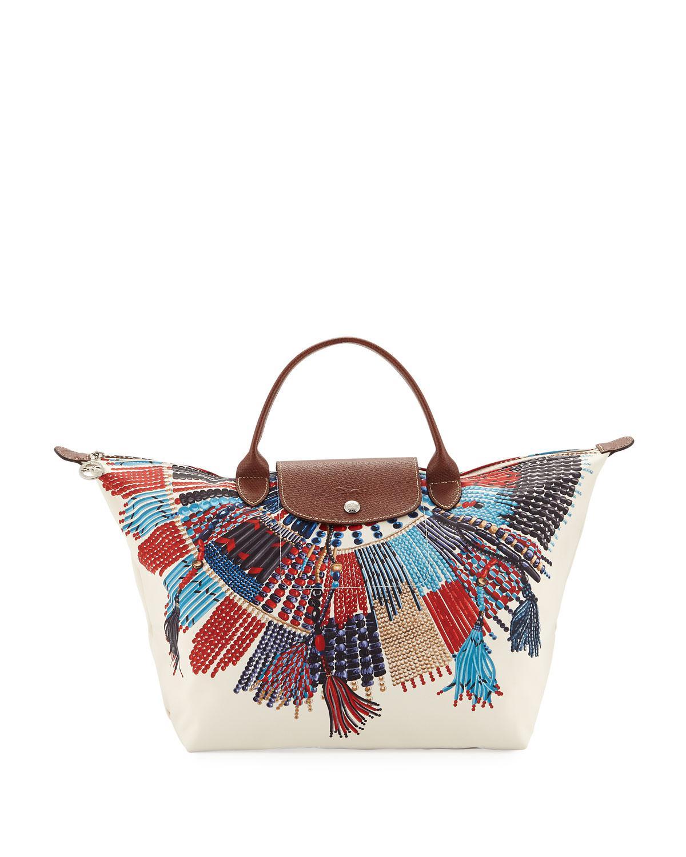 e7ac39d02b989 Lyst - Longchamp Le Pliage Collier Massai Medium Top Handle Bag ...