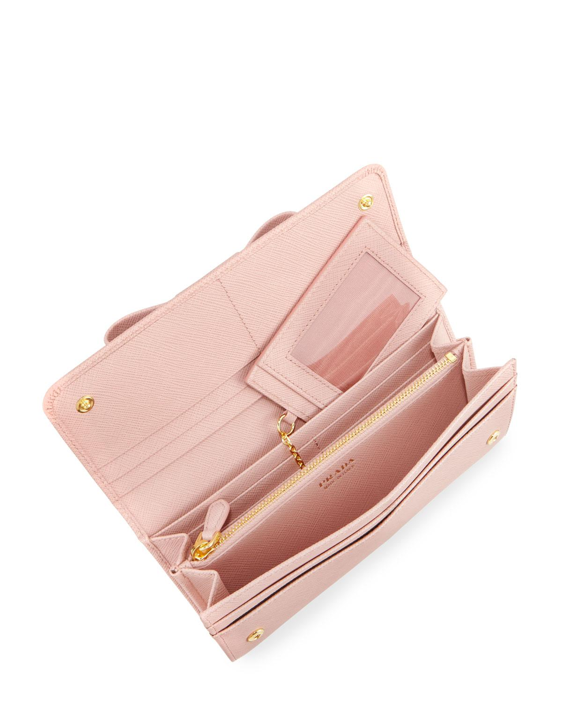 80e858cda6ea ... denmark lyst prada saffiano continental flap wallet with bow in pink  fea2f 6c7f6