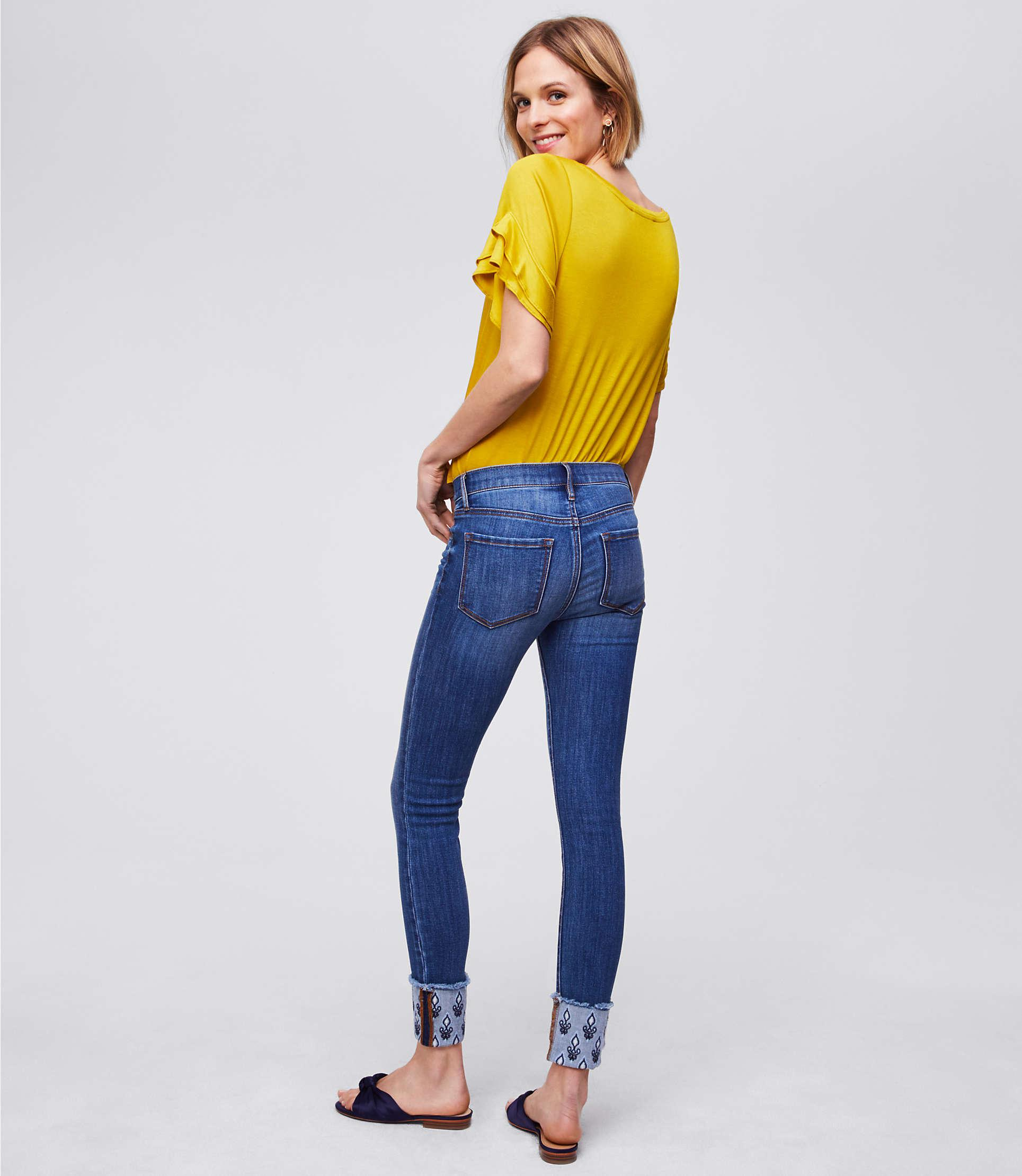 b6fd296c172bb Lyst - LOFT Modern Floral Embroidered Cuffed Skinny Jeans in Blue