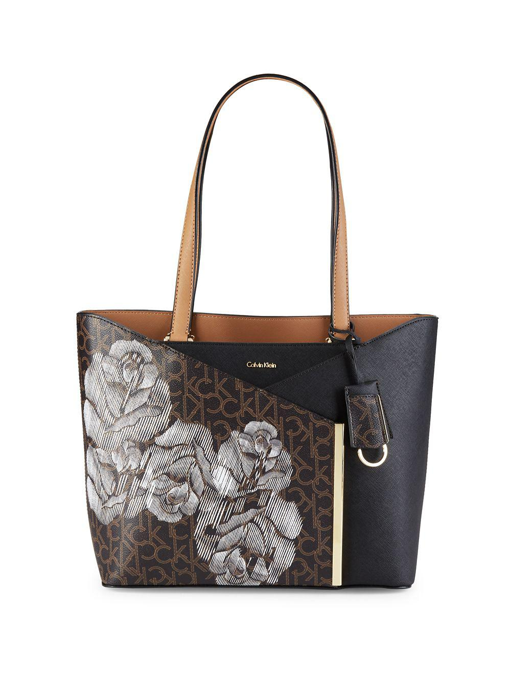 62789fc7ba Calvin Klein Sketched Floral Leather Tote in Black - Lyst