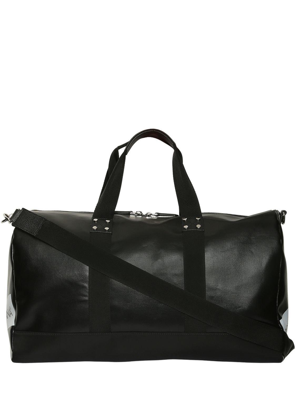 e20b65107a11 Lyst - Dolce   Gabbana Logo Tape Coated Canvas Duffle Bag in Black ...