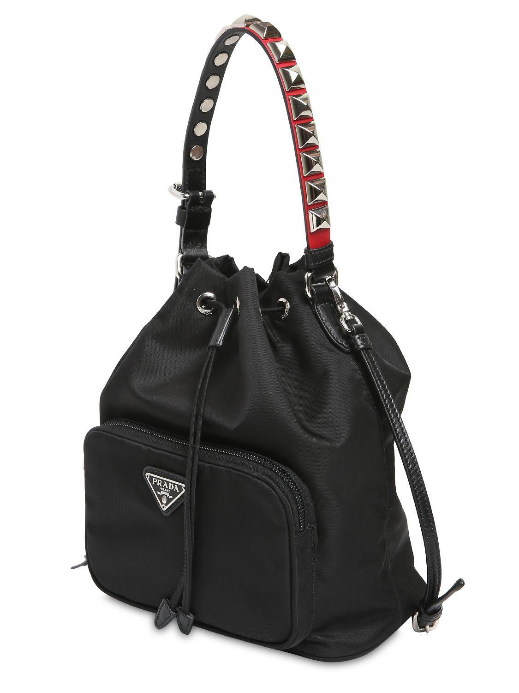 87c1cb4bc1cf Prada New Vela Nylon Bucket Bag W/ Studs in Black - Lyst