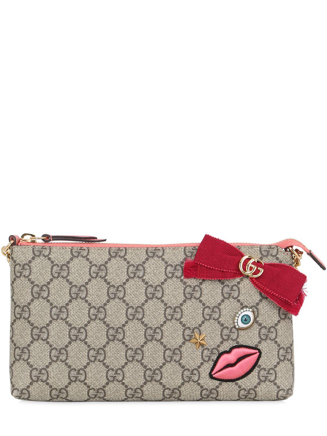 606148fb573 Gucci Circus Embroidered Gg Supreme Clutch - Lyst