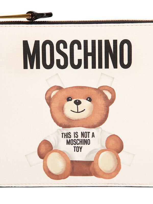 cb1012dd0a0e Lyst - Moschino Teddy Bear Tab Print Faux Leather Pouch in White