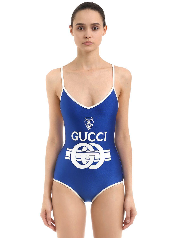 faaeb318d5469 Gucci Logo Printed Shiny Lycra Swimsuit in Blue - Lyst