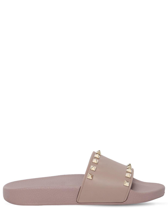 14da8ebf8c0a Valentino. Women s Rockstud Embellished Pvc Slide Sandals