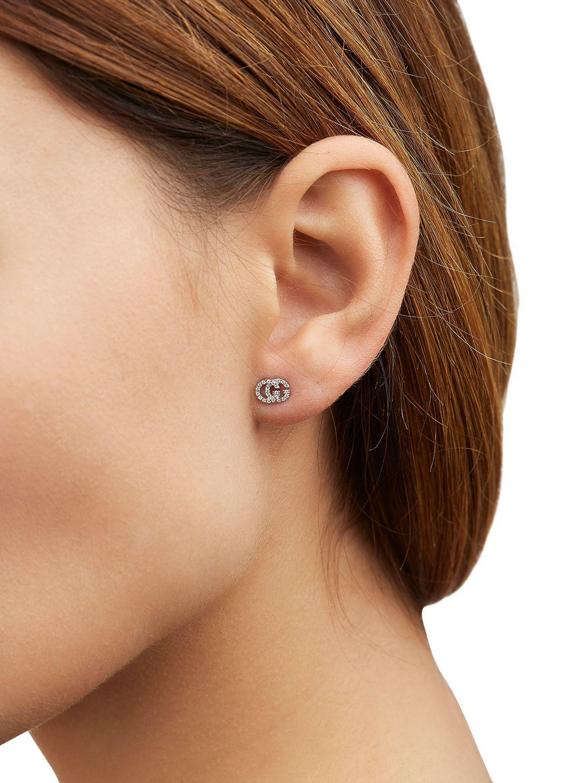 0acd5cd2cc3 Lyst - Gucci Running G Diamond Stud Earrings in White