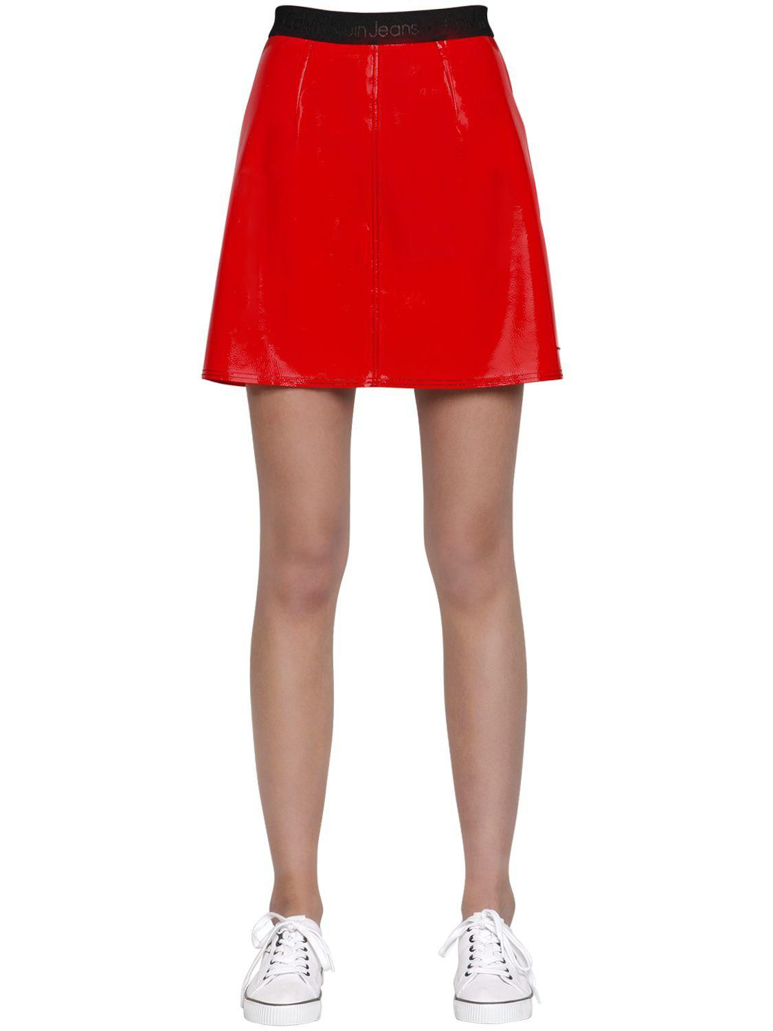 8f694684ee7d Calvin Klein Kiti Faux Patent Leather Mini Skirt in Red - Lyst