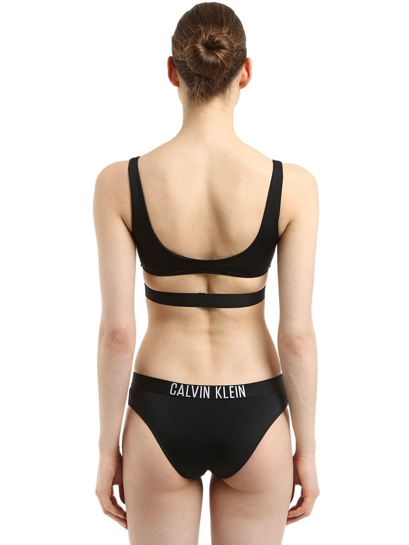9a4b4fcd26 Lyst - Calvin Klein Logo Band Bralette Bikini Top in Black