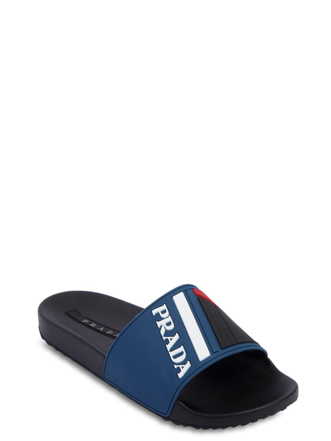 a91d32839bb Lyst - Prada Graphic Logo Pool Slides in Blue for Men - Save 62%