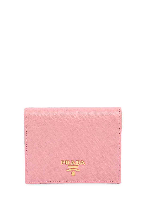 67a8147dc539d6 ... uk prada pink small saffiano leather snap wallet lyst. view fullscreen  ab39c b07d5