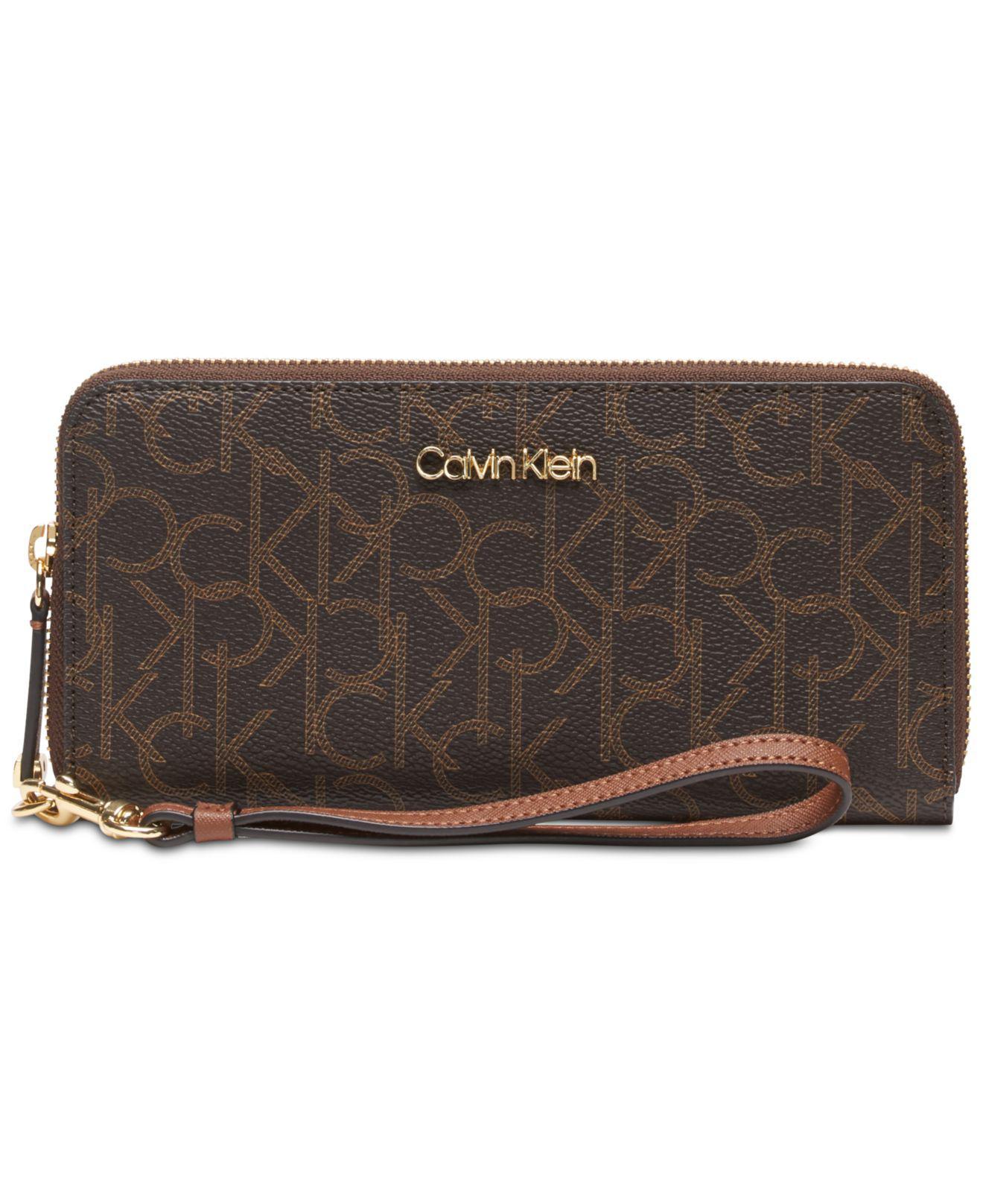 fee6e1d80748 Calvin Klein Signature Zip-around Wallet in Brown - Save 31% - Lyst