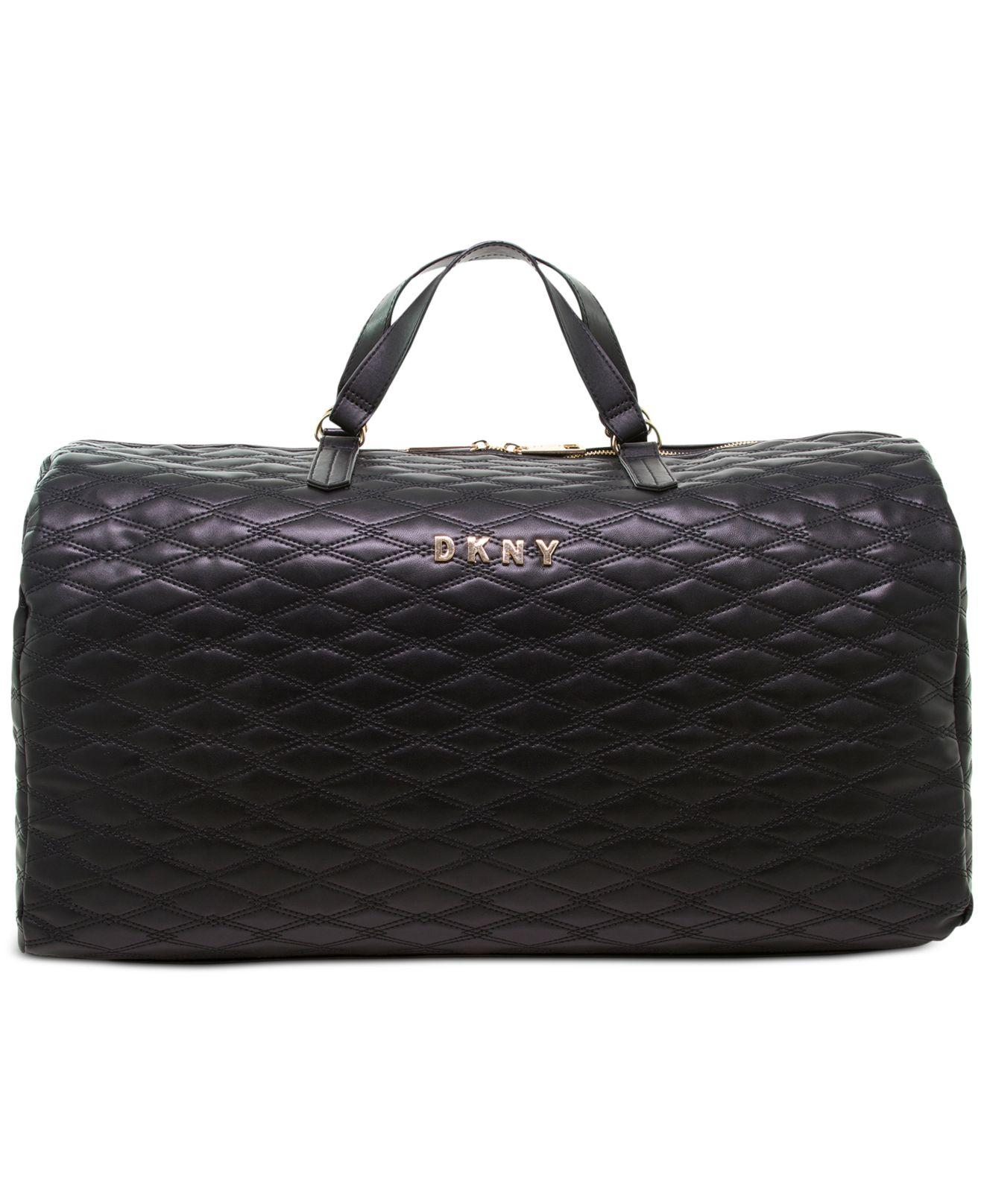 6c73caa6ba33 Lyst - DKNY Allure Quilted Barrel Duffle Large in Black