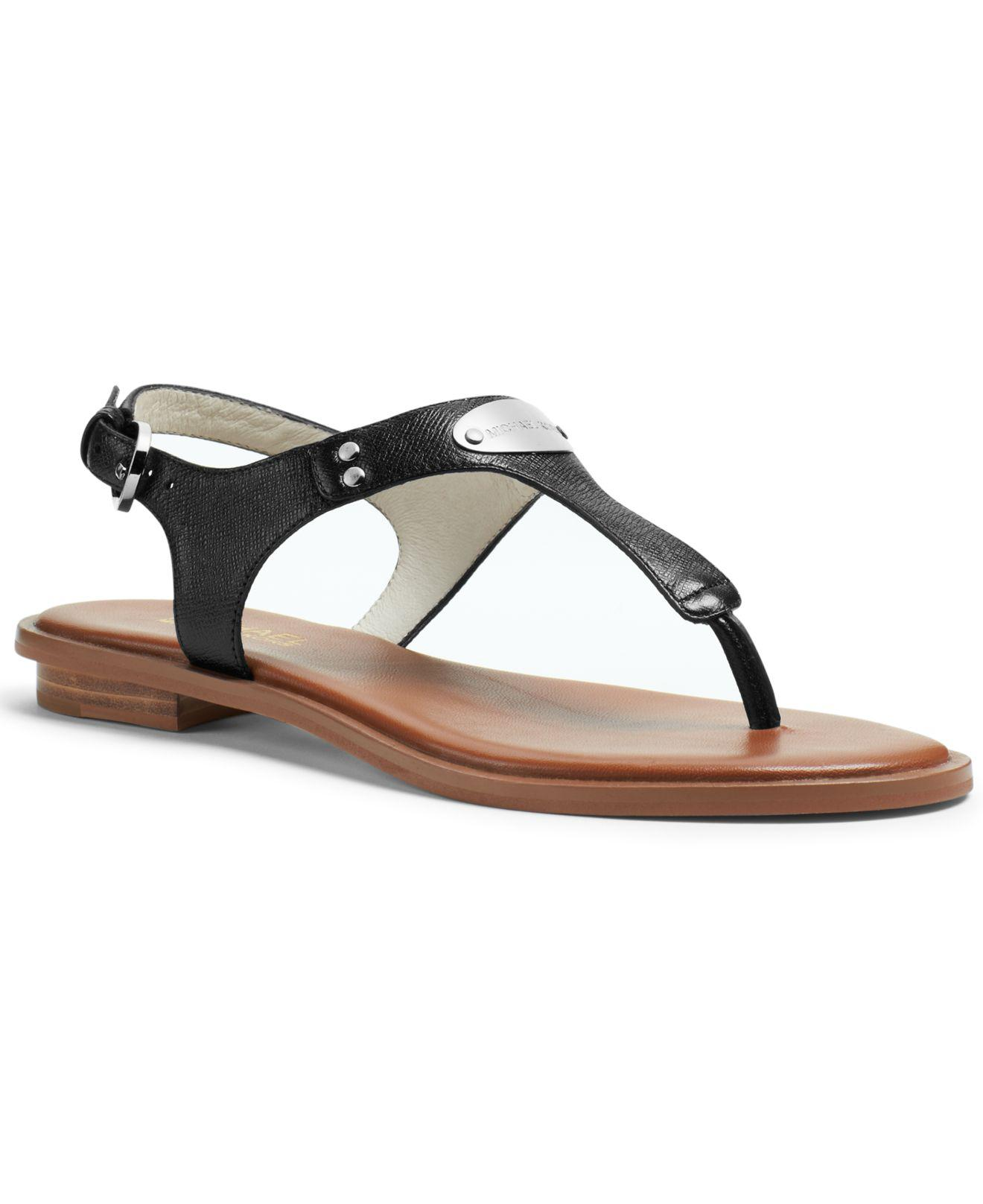 9f715884fad1 Michael Kors Mk Plate Flat Thong Sandals in Black - Lyst