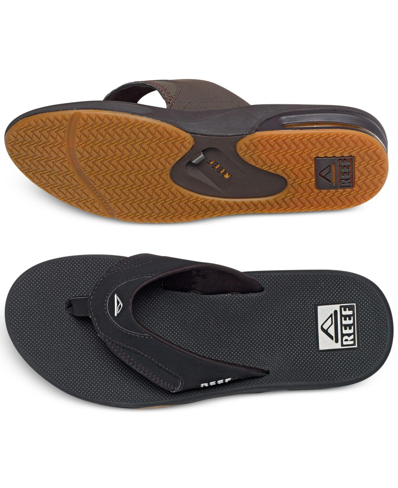 reef fanning thong sandals with bottle opener in black for men lyst. Black Bedroom Furniture Sets. Home Design Ideas
