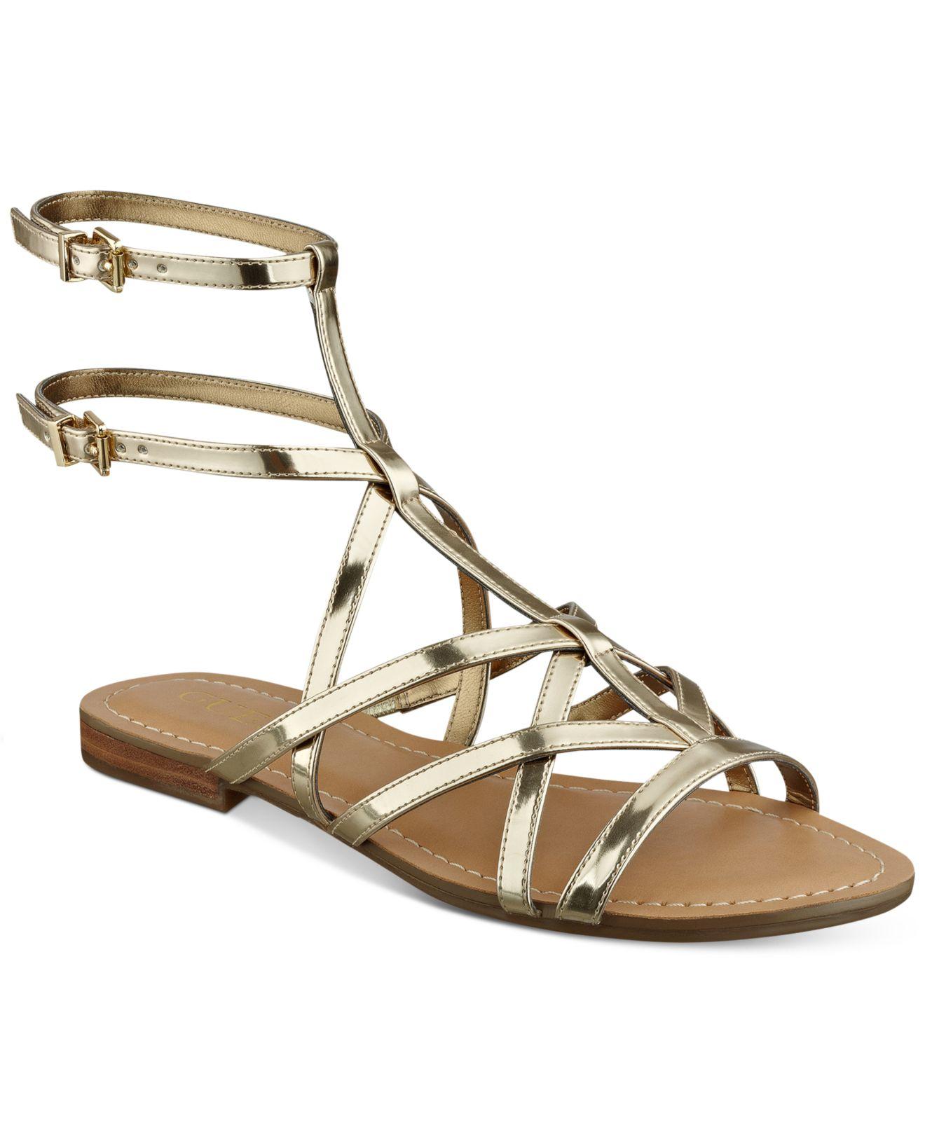 Guess Women S Mannie Strappy Flat Sandals In Metallic Lyst