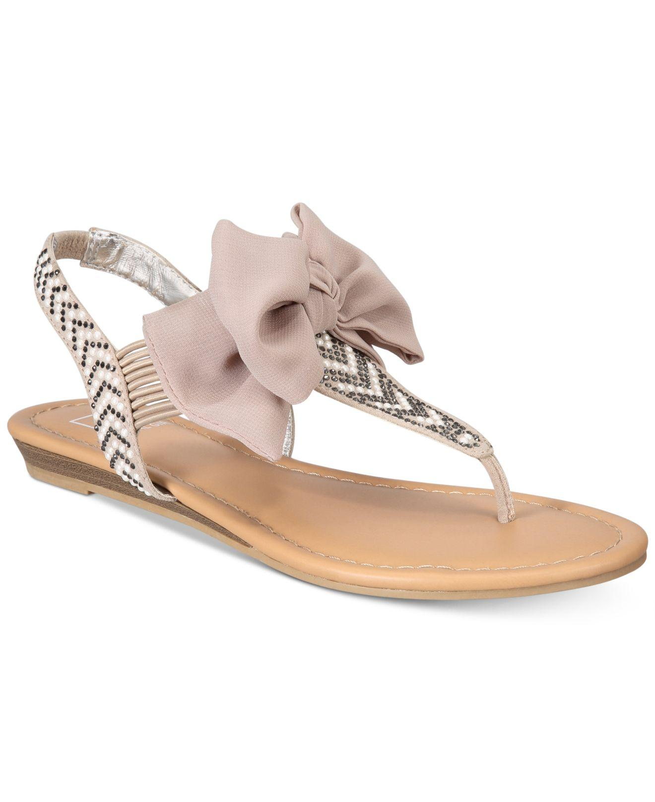 accccd64bca1 Material Girl. Women s Swan Flat Thong Sandals ...