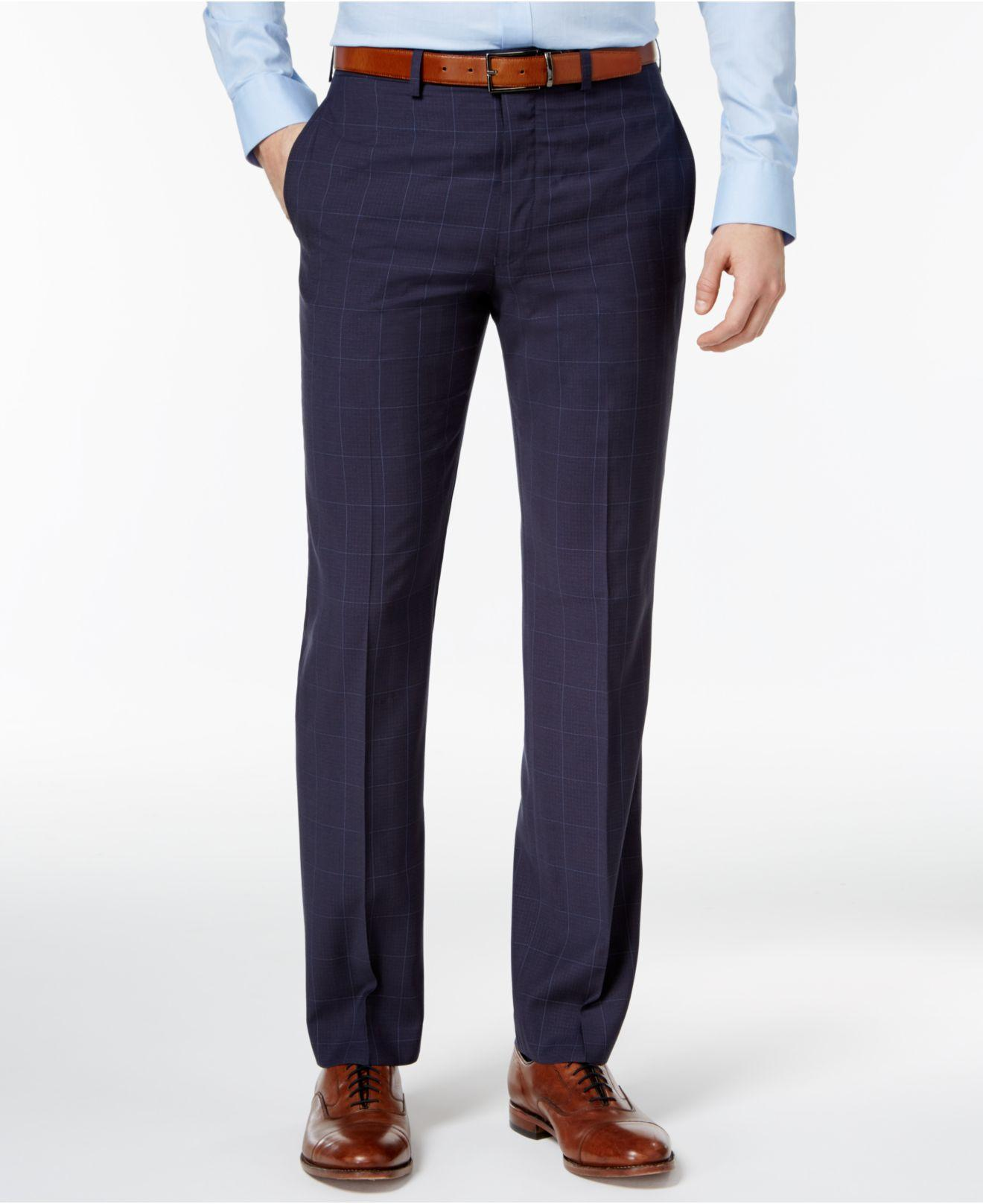 sleek and comfortable, these navy dress pants feature slight stretch, an extended tab closure, multiple pockets and versatile formal styling.