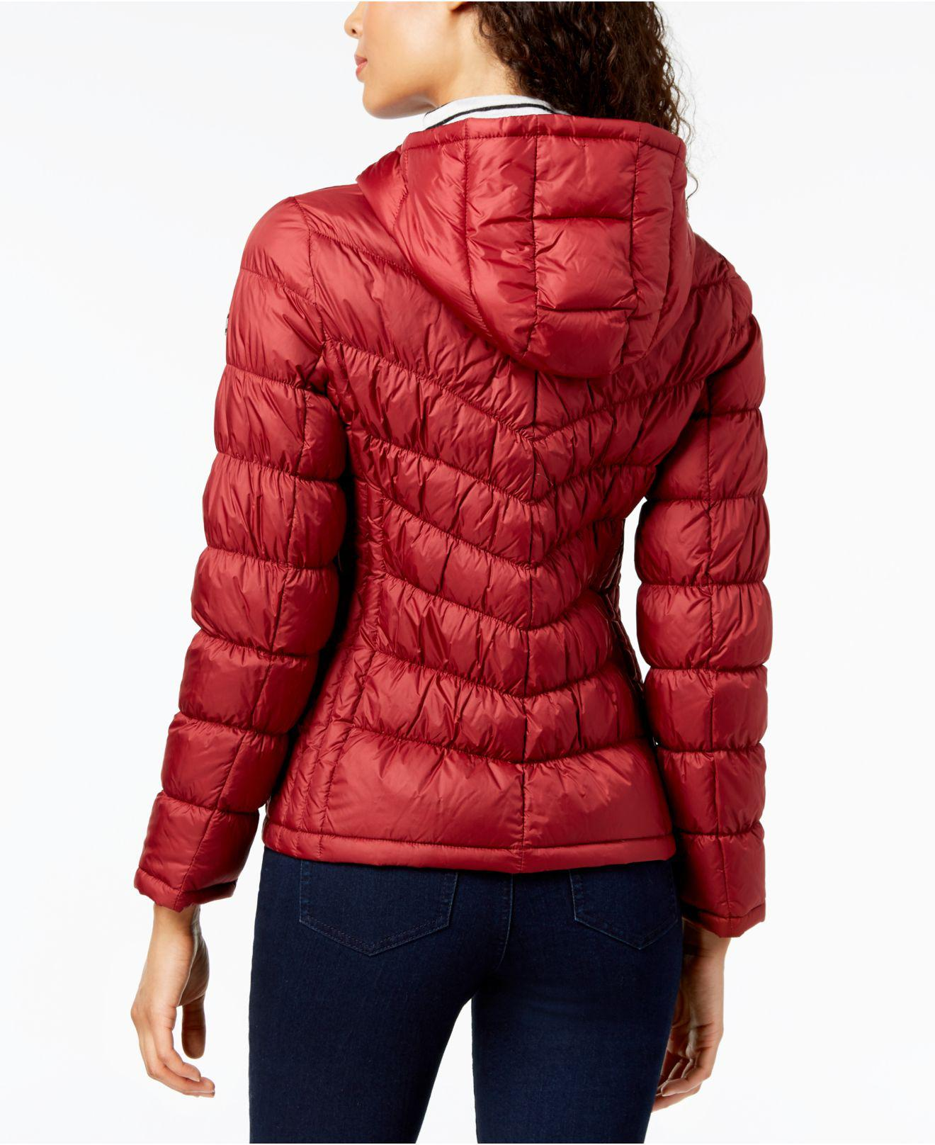 c6142d6efb0 Michael Kors Michael Hooded Packable Puffer Coat in Red - Save 5% - Lyst