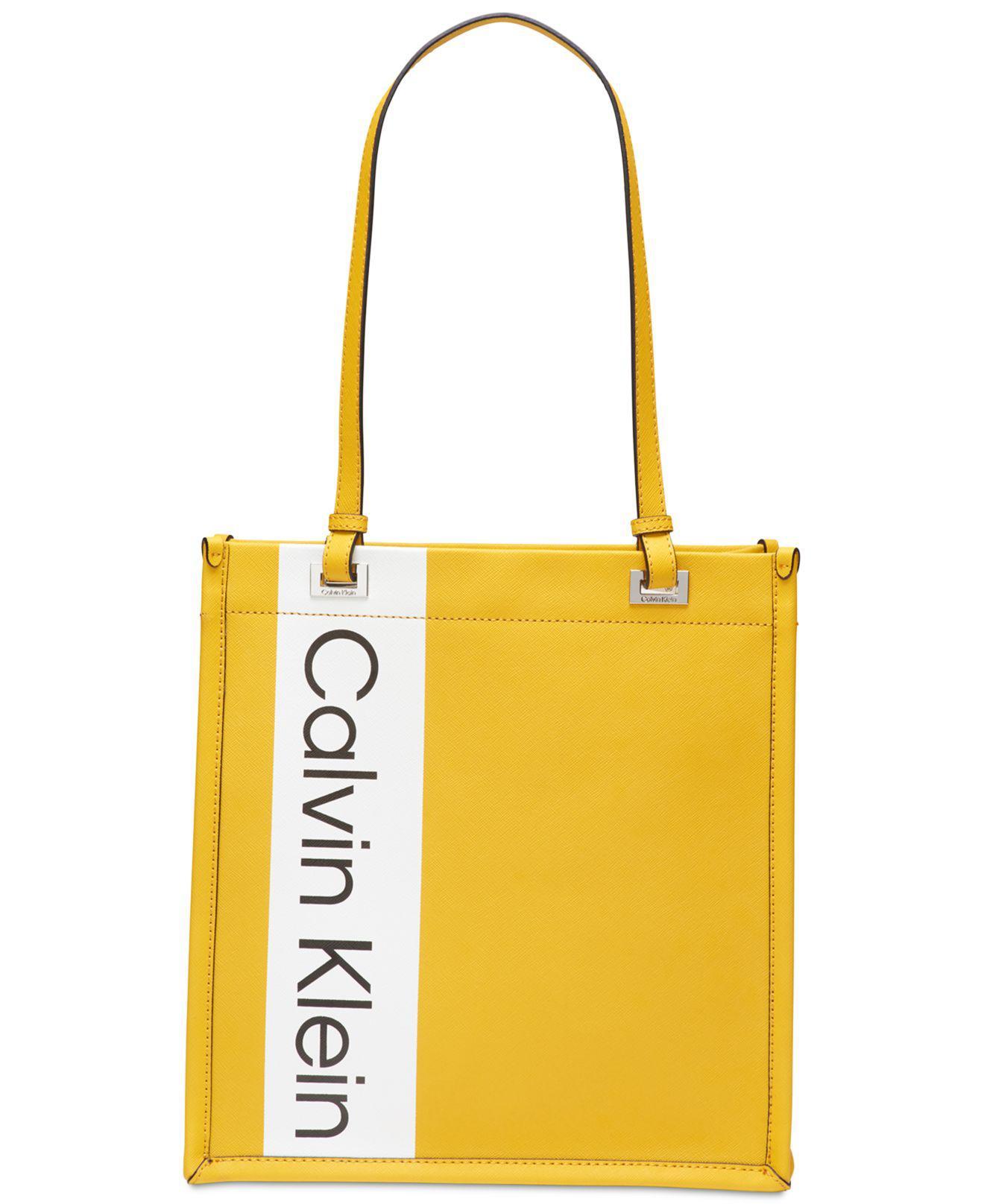 4cd79460a9 Calvin Klein Franzy Logo Tote in Yellow - Lyst