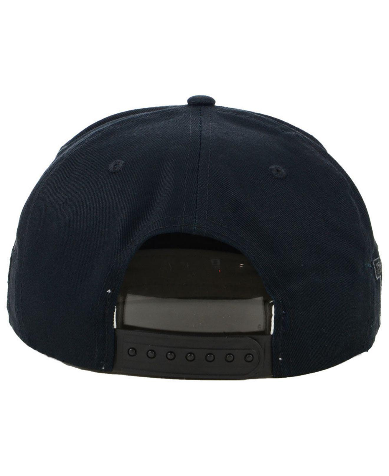 7f1c87bfabb6 ... switzerland nike washington huskies sport specialties black on black  snapback cap for men lyst. view