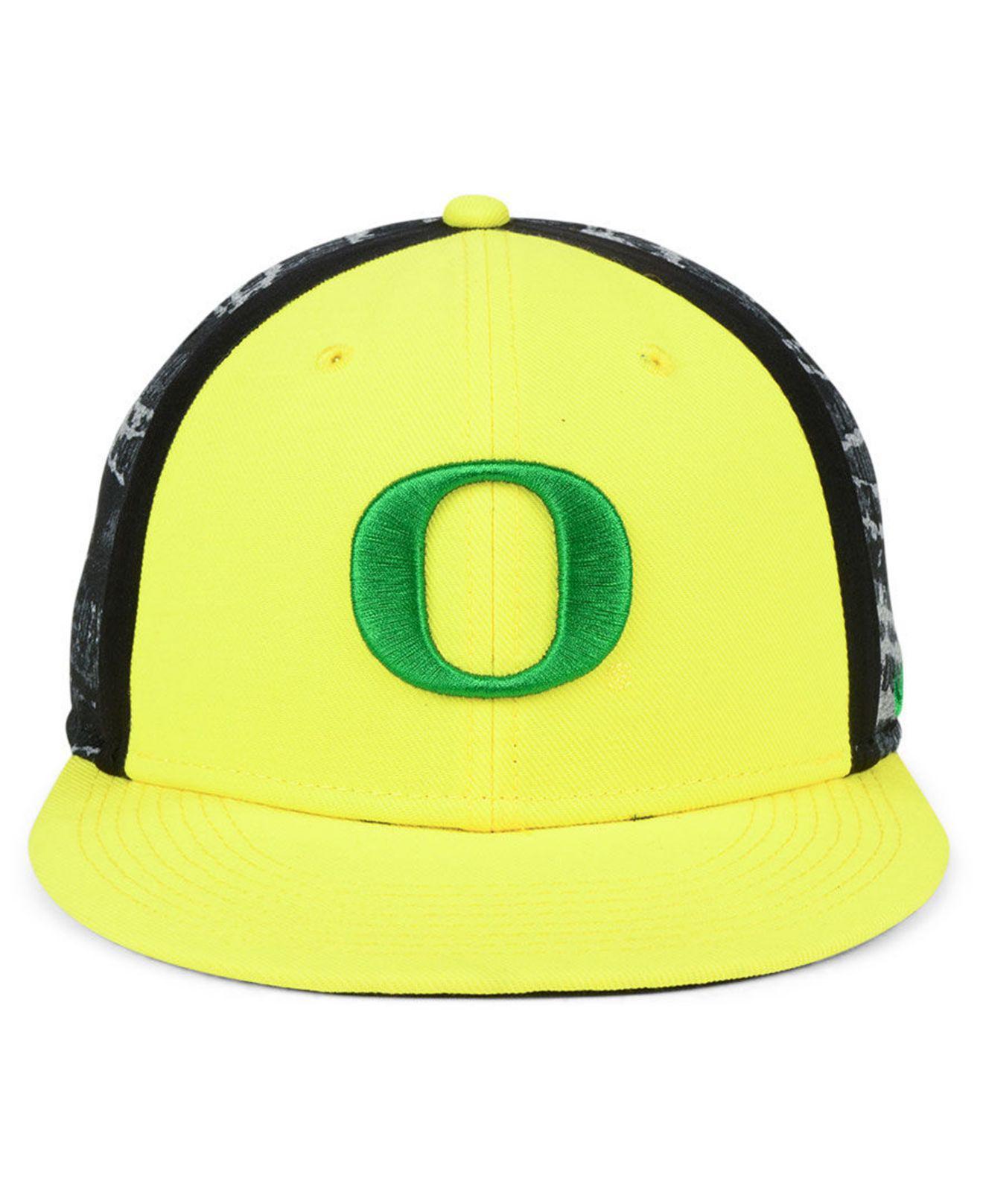 low priced 46ef5 3f206 ... netherlands nike yellow oregon ducks dna true snapback cap for men lyst.  view fullscreen d2d82