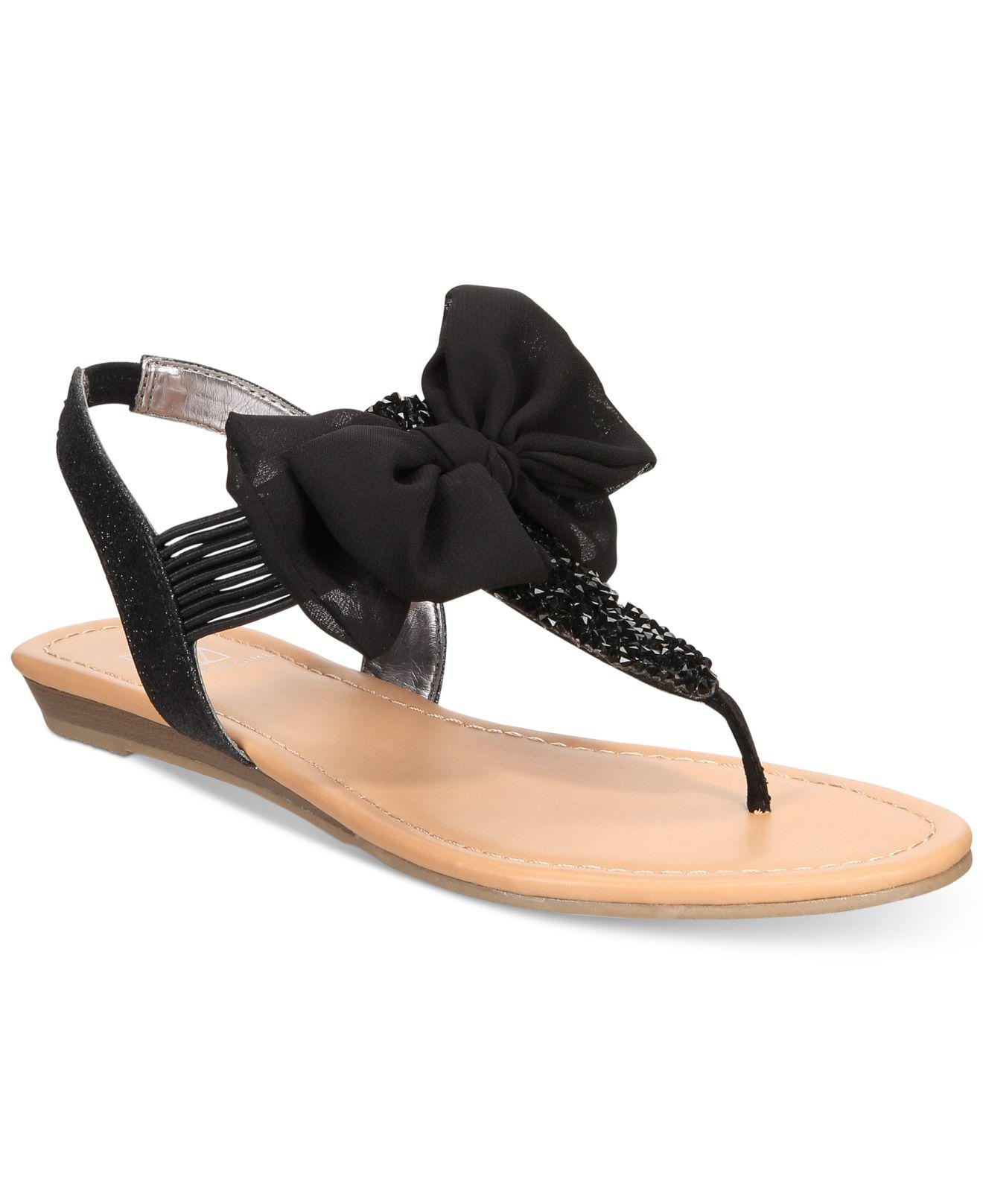 2c4f4aaecf3 Material Girl. Women s Black Swan Flat Thong Sandals