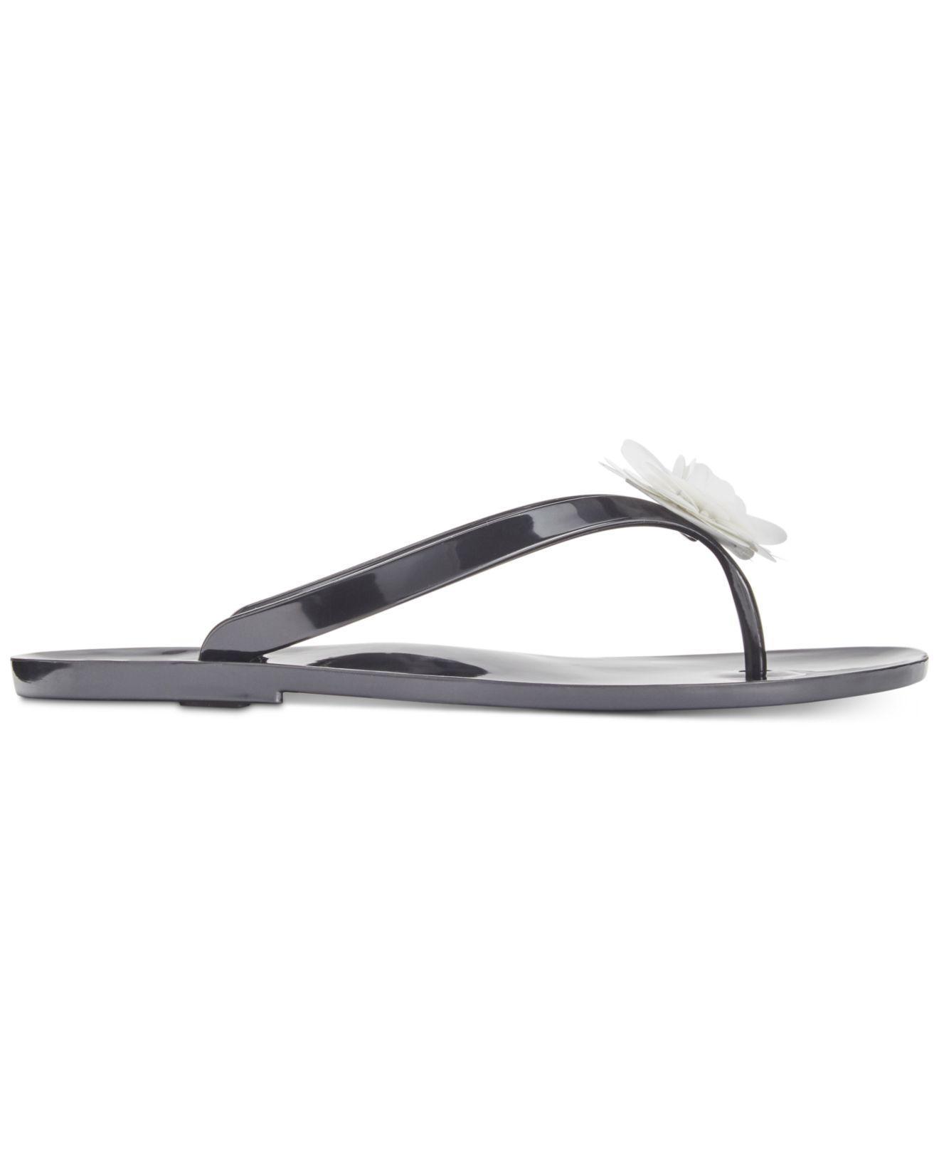 c06fce43ab12 Lyst - Kate Spade Fiorina Jelly Flip Flops in Black