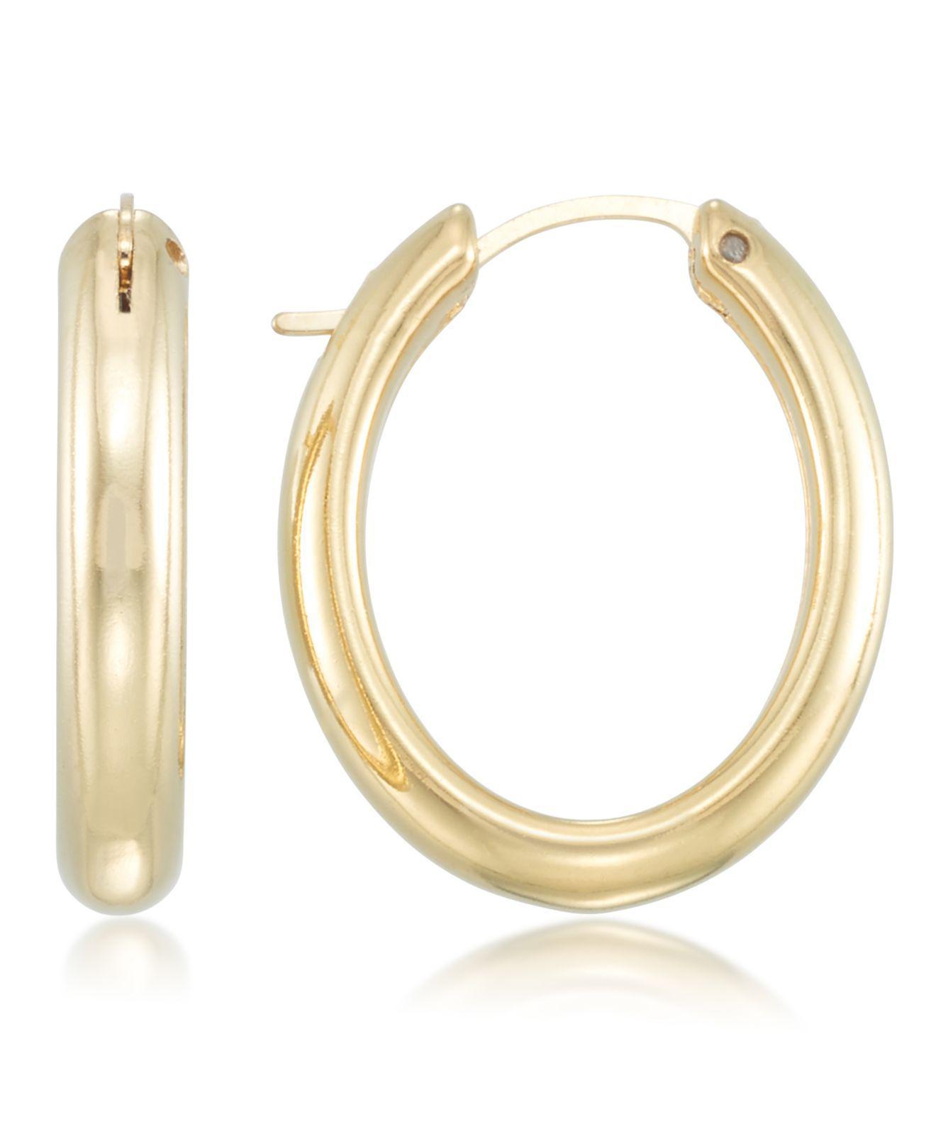 fb21422fa2bae Lyst - Signature Gold Tm Diamond Accent Polished Oval Hoop Earrings ...