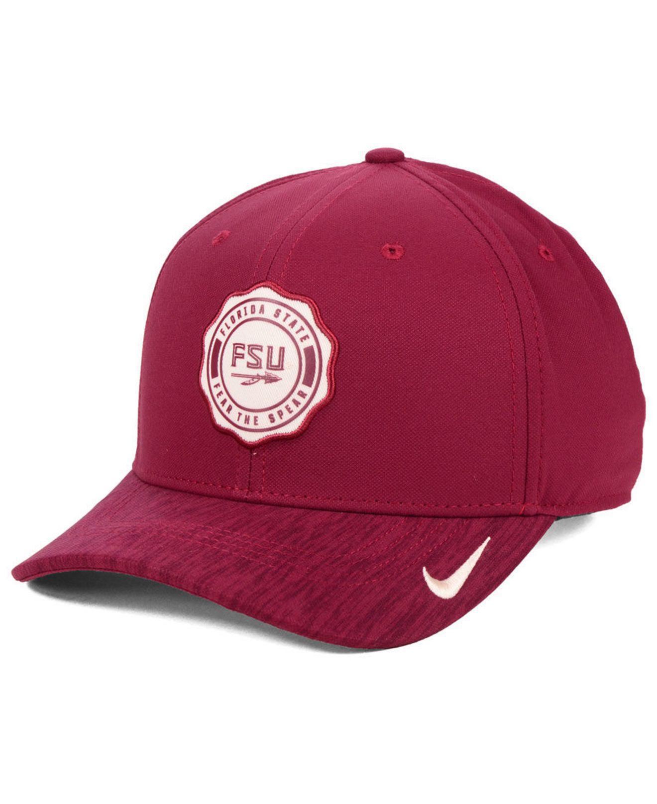 buy online 228d2 def0c Nike. Men s Red Florida State Seminoles Rivalry Swooshflex Stretch Fitted  Cap