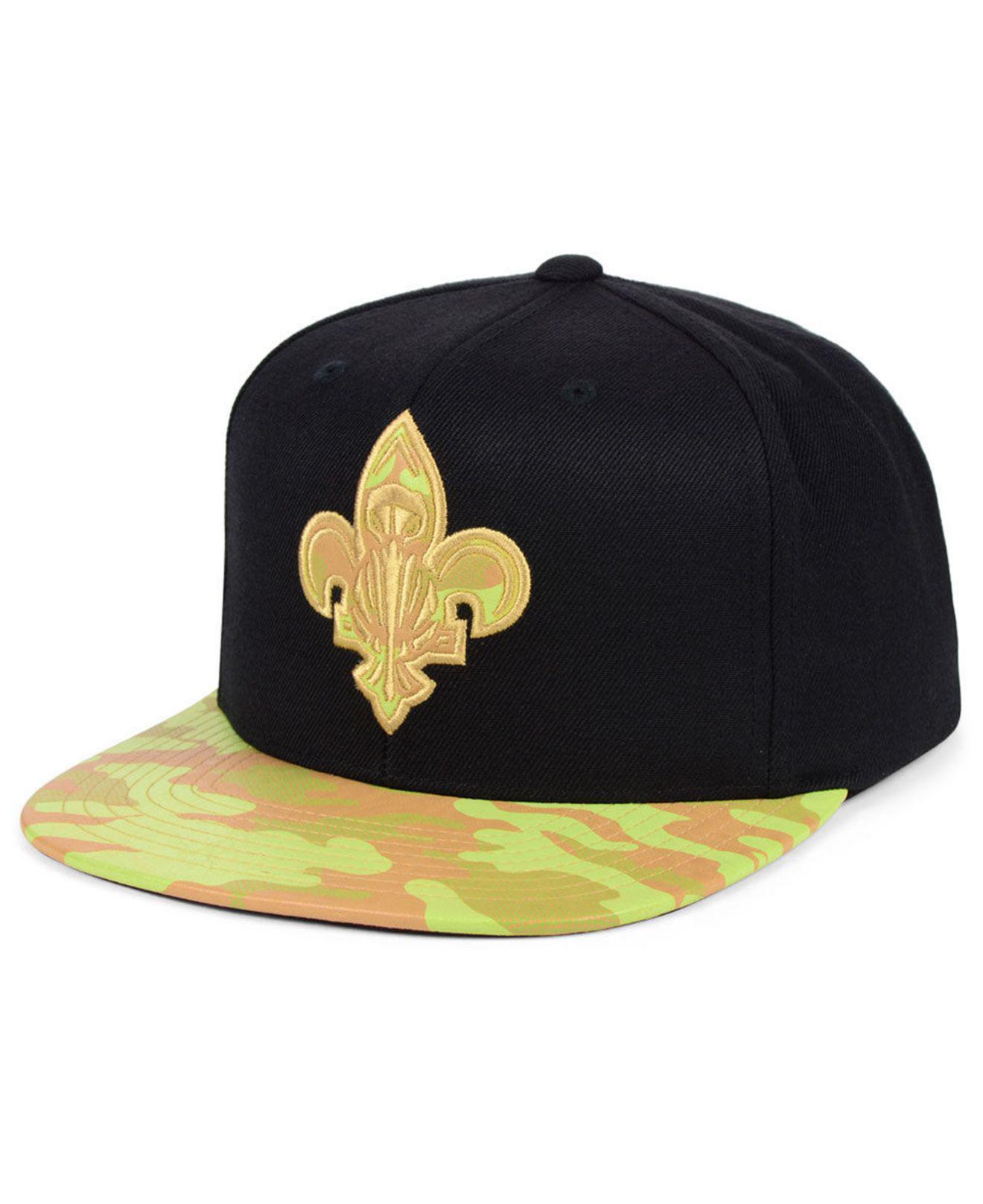 big sale 2b67f 9d7e1 Mitchell   Ness. Men s Black New Orleans Pelicans Natural Camo Snapback Cap