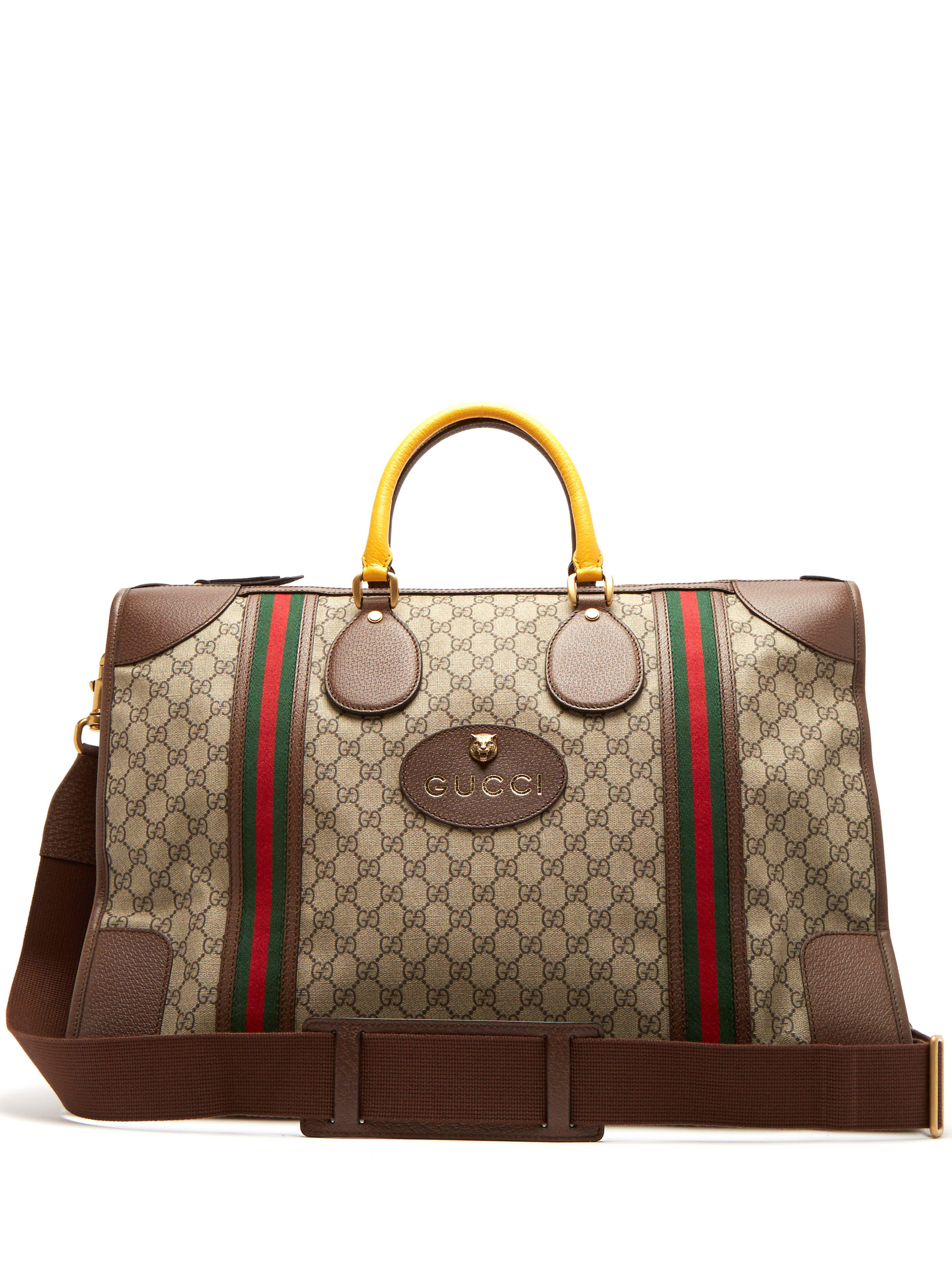 Gucci Gg Supreme Canvas And Leather Holdall in Brown for Men - Save ... 53e35c09c34ca