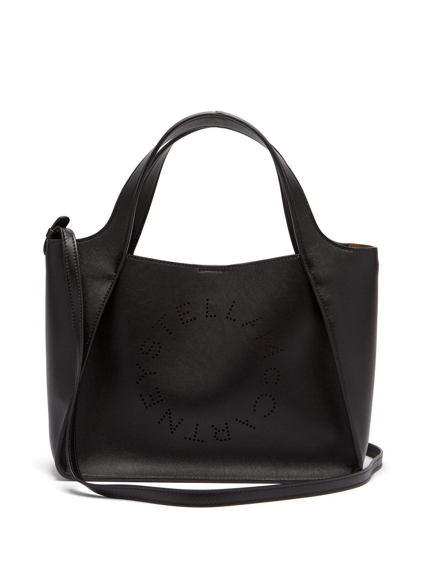 Stella McCartney. Women s Black Stella Perforated Logo Faux Leather Tote Bag ec34f2247a7d1