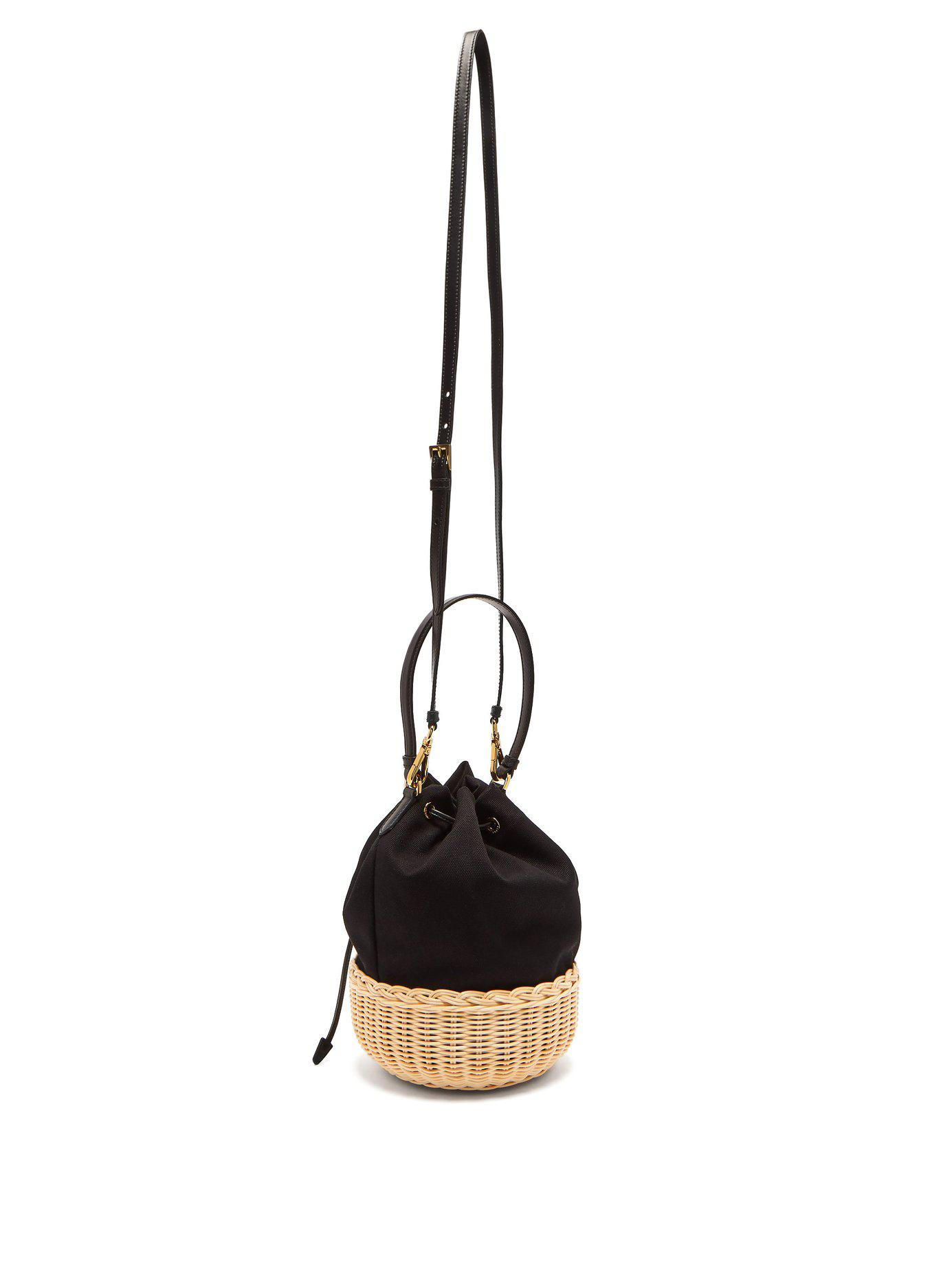 7c05486ee0a6 Lyst - Prada Canvas And Woven Straw Bucket Bag in Black