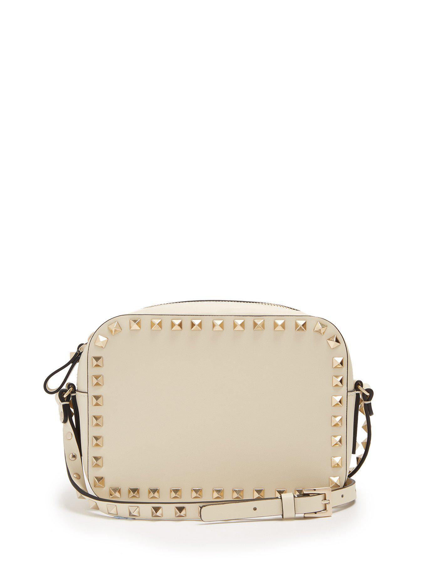 4158b914641d Lyst - Valentino Rockstud Camera Leather Cross Body Bag in White