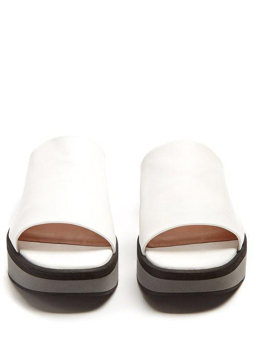 d67b90dcc72 Clergerie Quenor Leather Platform Slides in White - Lyst