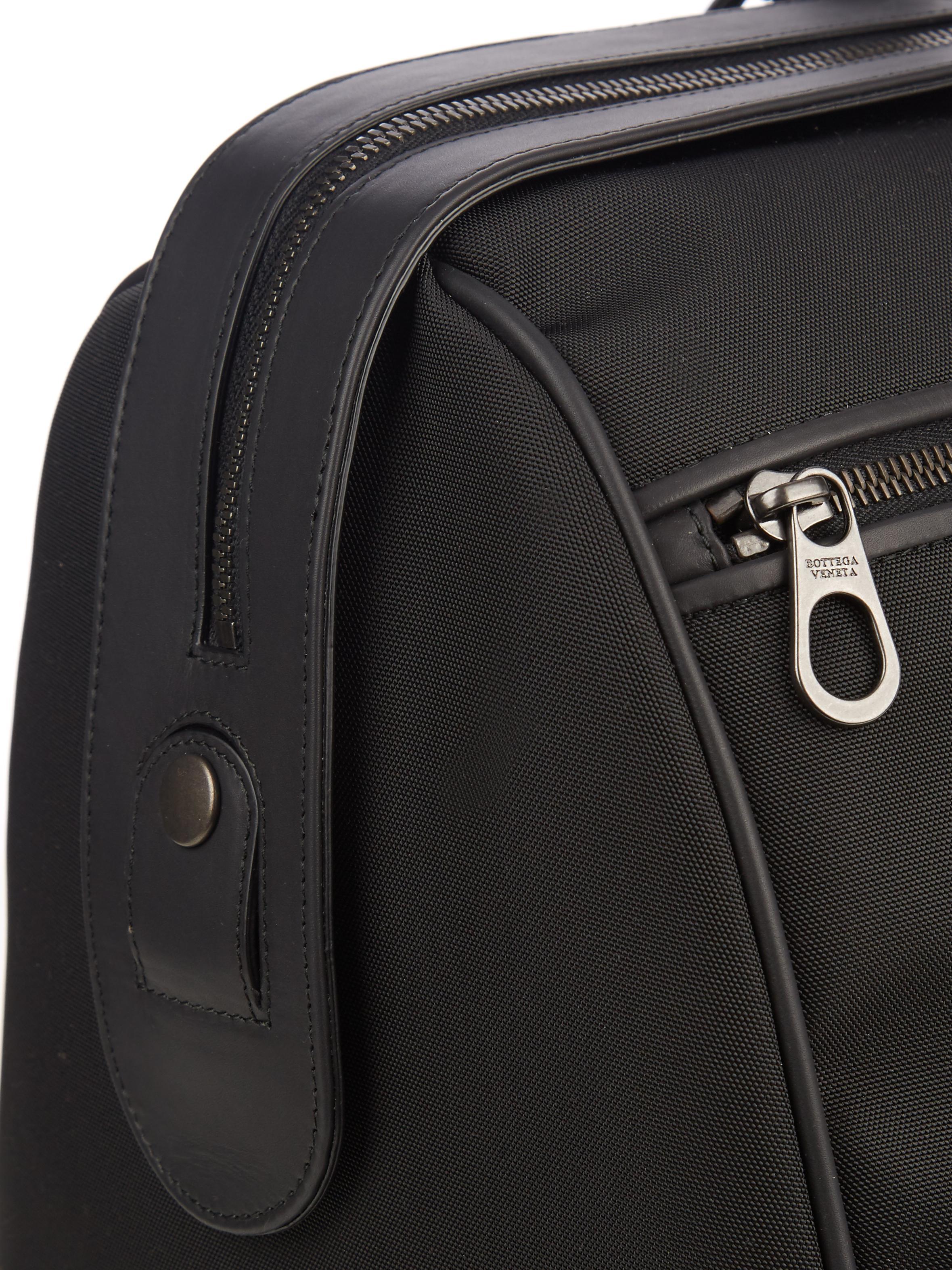 a79abc56c69f Bottega Veneta Intrecciato Leather-trim Canvas Travel Bag in Black ...