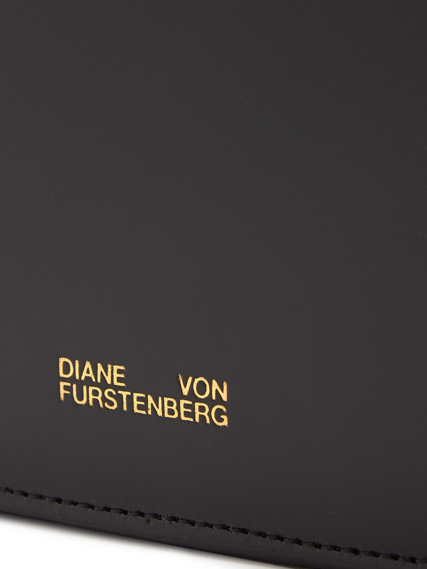 Saddle bi-colour leather and calf-hair clutch Diane Von F nKG2Lo6S4